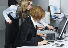 Businesswoman and computer Royalty Free Stock Images