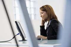 Businesswoman on computer Royalty Free Stock Image