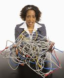 Businesswoman with computer cords. Royalty Free Stock Images