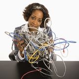 Businesswoman with computer cords. Royalty Free Stock Photography