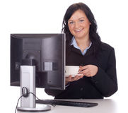 Businesswoman with computer and cup Stock Images
