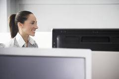 Businesswoman At Computer Desk Looking Away Royalty Free Stock Photography