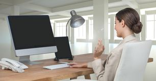 Businesswoman on computer at desk in office Royalty Free Stock Photos