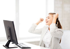 Businesswoman with computer in office Royalty Free Stock Image