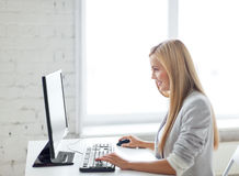 Businesswoman with computer in office Royalty Free Stock Photos