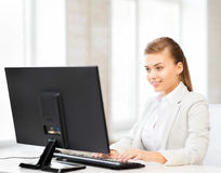 Businesswoman with computer in office Stock Photo