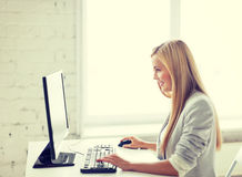 Businesswoman with computer in office Stock Photos
