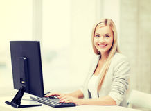 Businesswoman with computer Stock Images