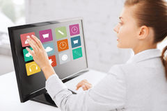 Businesswoman with computer touchscreen in office Stock Photo
