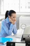Businesswoman concentrating on computer work Royalty Free Stock Photography