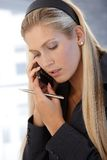 Businesswoman concentrating on phone call Royalty Free Stock Photography