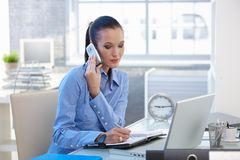 Businesswoman concentrating on phone call Stock Images