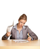 Businesswoman concerned with paperwork Royalty Free Stock Photo