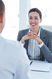 Businesswoman conducting an interview with businessman Stock Photos