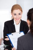 Businesswoman conducting interview Royalty Free Stock Images