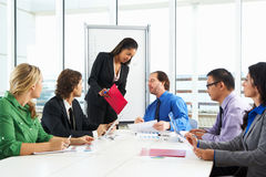 Businesswoman Conducting Meeting In Boardroom Royalty Free Stock Photography