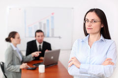 Businesswoman in a conference room. A young businesswomen participates at a meeting, at her workplace Stock Images