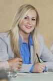Businesswoman At Conference Table Stock Photo