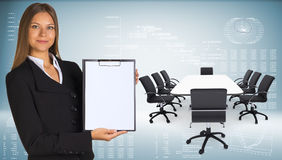 Businesswoman with conference table, chairs and Royalty Free Stock Photos