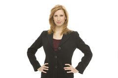 Businesswoman with confidence. A businesswoman in a suit stands confidently Stock Image