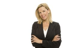 Businesswoman with confidence. A blonde businesswoman crosses her arms with confidence Stock Images