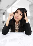 Businesswoman are confused. With a pen on the desk in the office Royalty Free Stock Photo