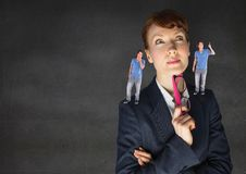 Businesswoman confused between being good or bad conscience Royalty Free Stock Images