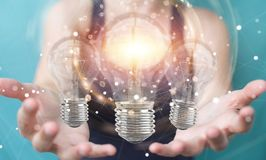 Businesswoman connecting modern lightbulbs with connections 3D r Stock Photo