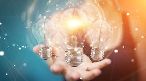 Businesswoman connecting modern lightbulbs with connections 3D r Royalty Free Stock Photos