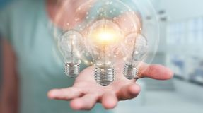 Businesswoman connecting modern lightbulbs with connections 3D r Royalty Free Stock Image