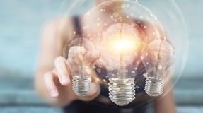 Businesswoman connecting modern lightbulbs with connections 3D r Royalty Free Stock Images