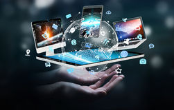 Businesswoman connecting tech devices to each other 3D rendering. Businesswoman on blurred background connecting tech devices 3D rendering Royalty Free Stock Image