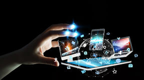 Businesswoman connecting tech devices to each other 3D rendering. Businesswoman on blurred background connecting tech devices 3D rendering Royalty Free Stock Photos