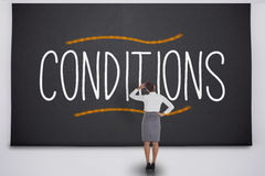 Businesswoman considering conditions Royalty Free Stock Images