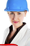 Businesswoman with construction helmet and clipboard documents. Stock Photography