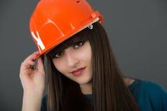 Businesswoman with construction helmet Stock Photos
