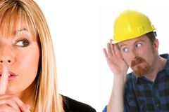 Businesswoman and construction worker Stock Images