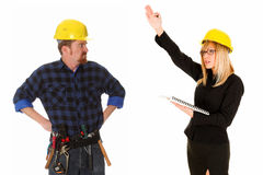 Businesswoman and construction worker royalty free stock photography