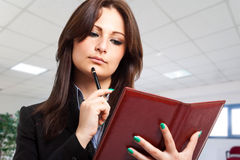 Businesswoman consulting agenda Royalty Free Stock Photos