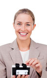 Businesswoman consulting a business card holder Stock Photos