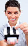 Businesswoman consulting a business card holder Royalty Free Stock Images
