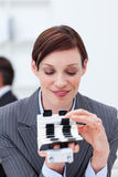 Businesswoman consulting her business card holder Stock Photos