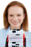 Businesswoman consulting her business card holder Royalty Free Stock Photography