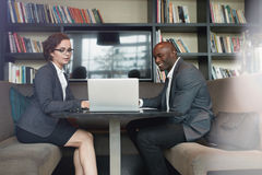 Businesswoman consulting her partner Stock Photo