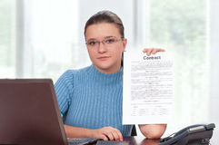 Businesswoman with contract Stock Images