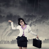 Businesswoman controlled by strings outdoors Stock Images
