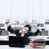 Businesswoman controlled by strings. Portrait of businesswoman working at office controlled by strings royalty free stock photography