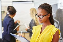 Businesswoman controlling plan with checklist. In meeting at office Royalty Free Stock Images