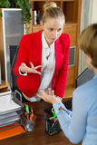 Businesswoman conversation with collegue Stock Images