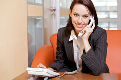 Businesswoman conversing on landline phone, portrait Royalty Free Stock Image